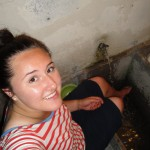 Hermana Hipol washing her feet on her back patio.